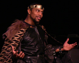 Jovan King as Macbeth